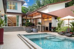 Outdoor swimming pool with counter bar in pool terrace